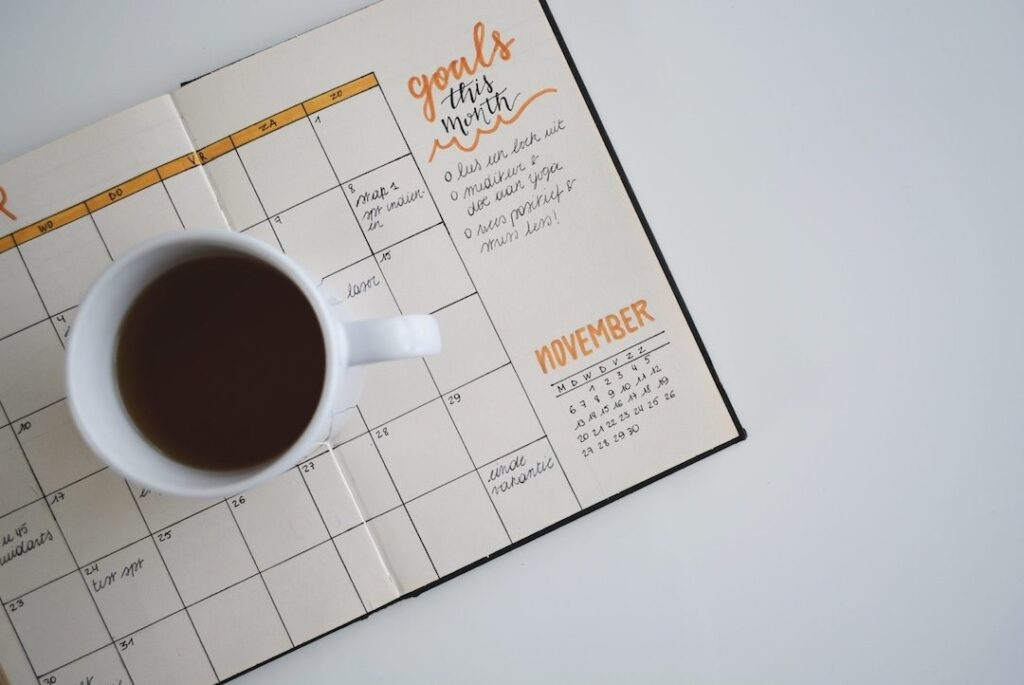 planner with cup of coffee
