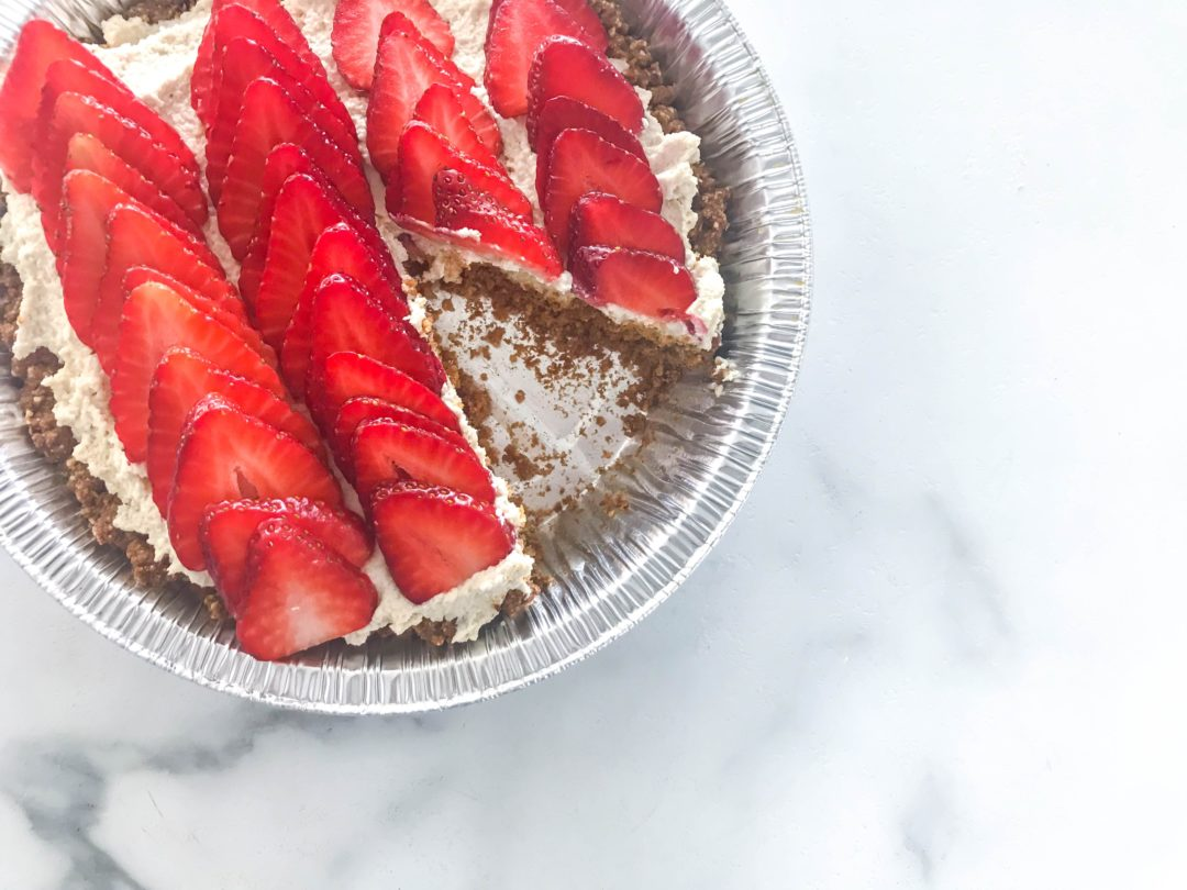 Half-baked Greek yogurt cheesecake with one slice cut out