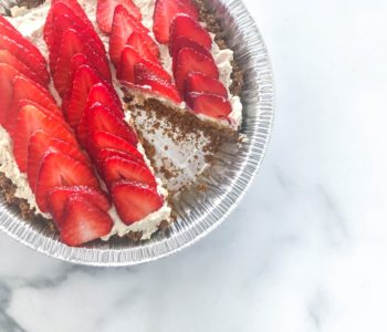 Half-baked Greek yogurt cheesecake with one slice cut out