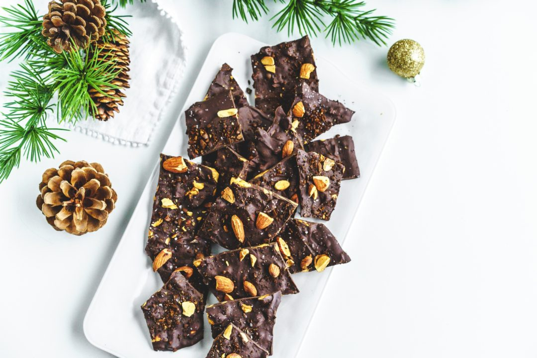 chocolate pieces with almonds on tray