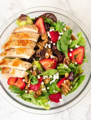 bowl containing strawberry walnut salad with chicken