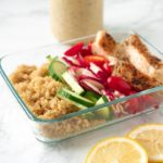 rectangular food container with quinoa, chicken and vegetables
