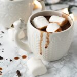 white mug filled with hot chocolate and marshmallows