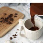 pouring hot chocolate into a white mug