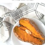 baked sweet potato sliced lengthwise with butter