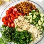 bowl with separated couscous salad ingredients